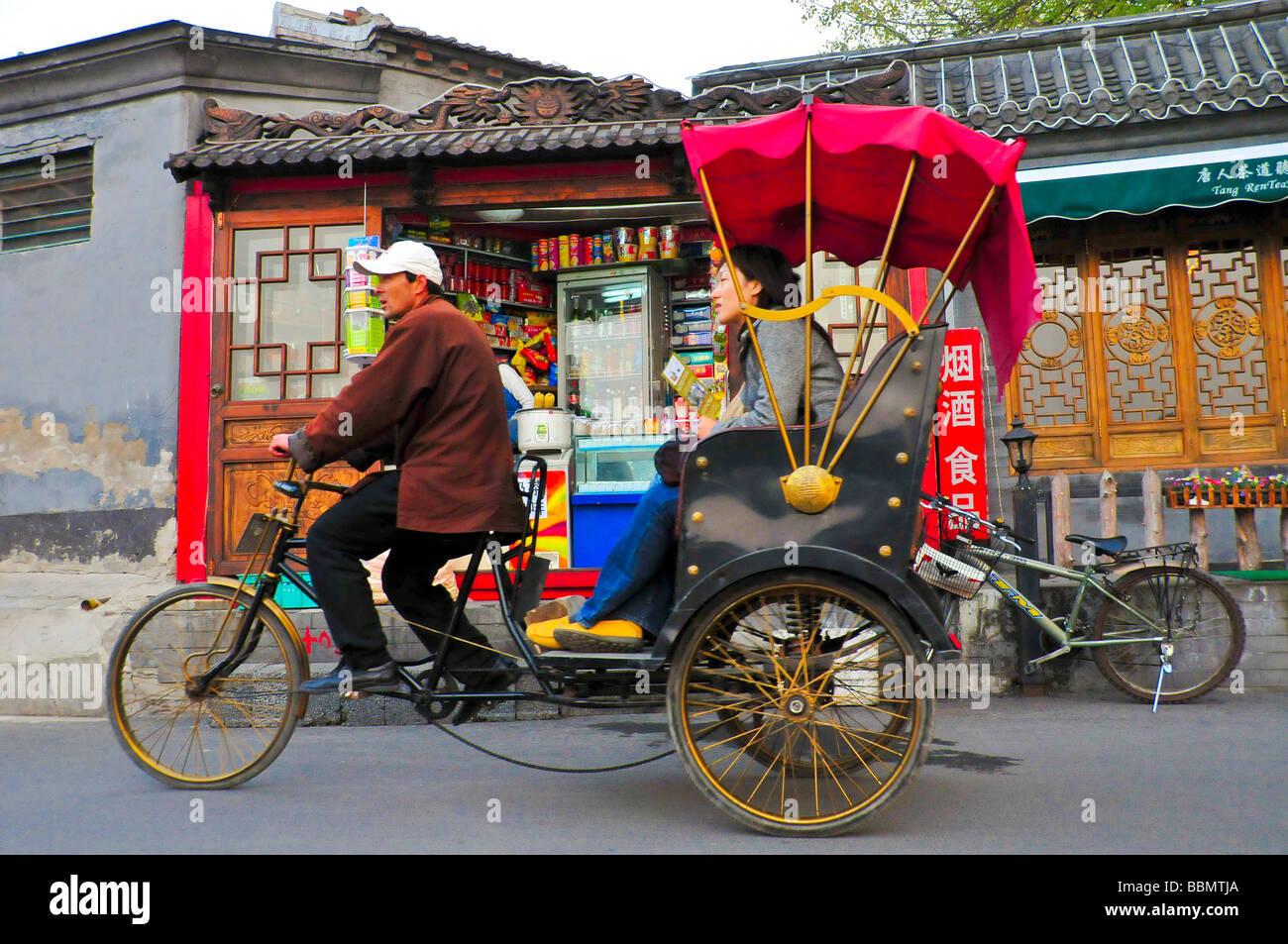Rickshaw in a hutong Beijing - Stock Image