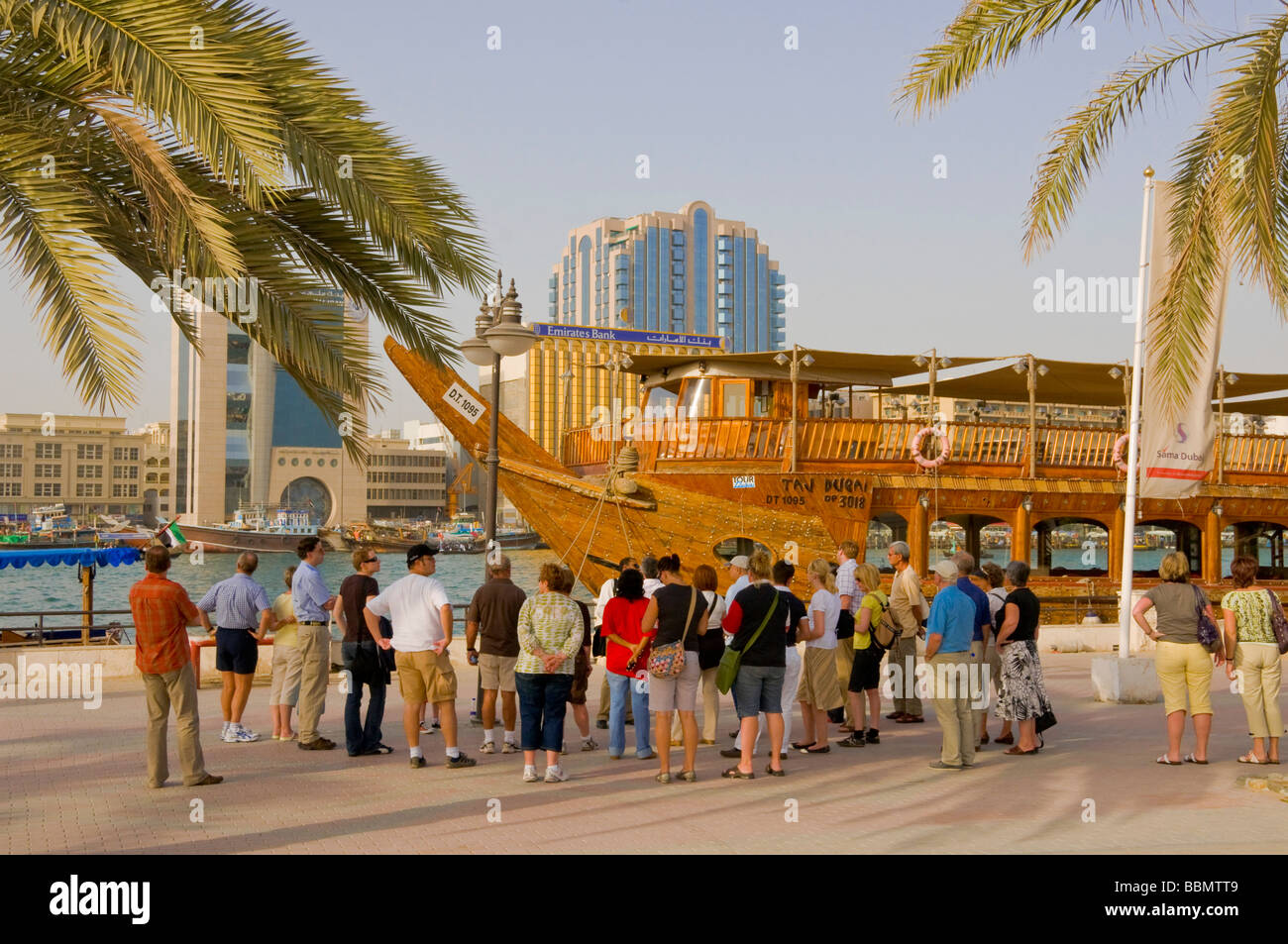 Group of foreign tourists in the Dubai creek - Stock Image