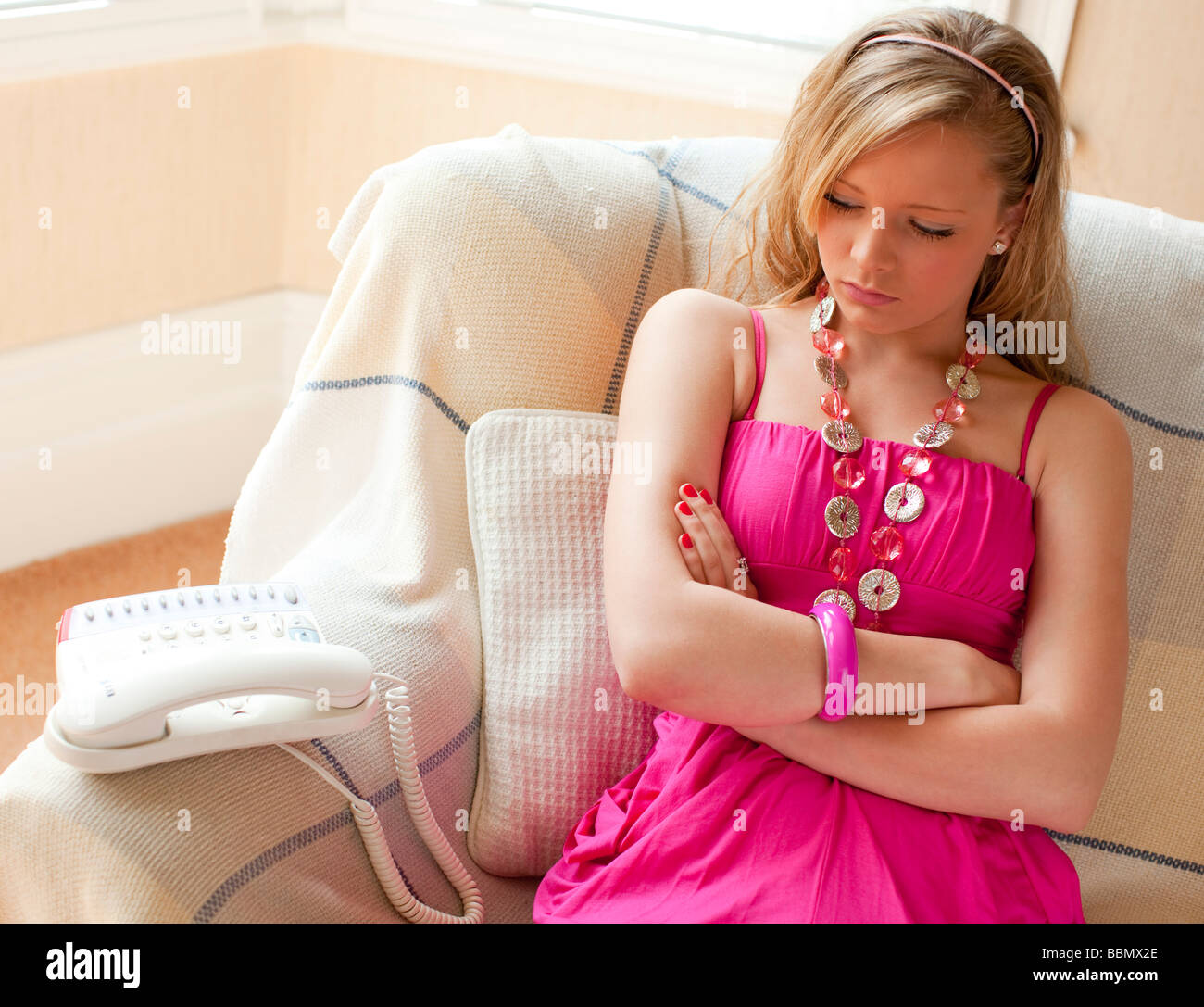 Young girl waiting for someone to call - Stock Image