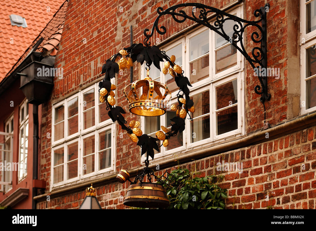 Old Inn hanging sign 'Krone', 'Crown', Lueneburg, Lower Saxony, Germany, Europe - Stock Image
