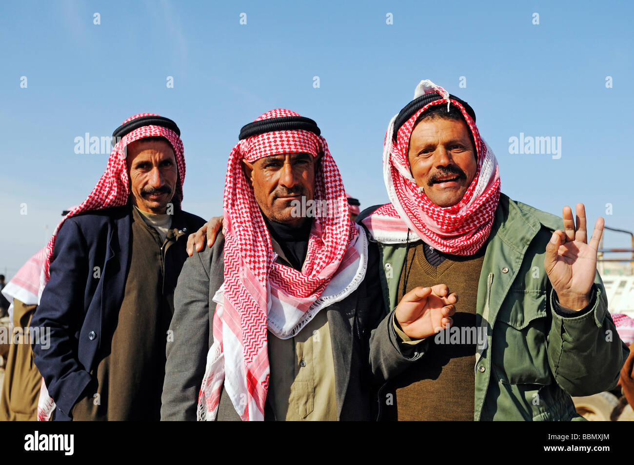Men on a market for sheep and goats, Kafseh, Syria, Asia - Stock Image