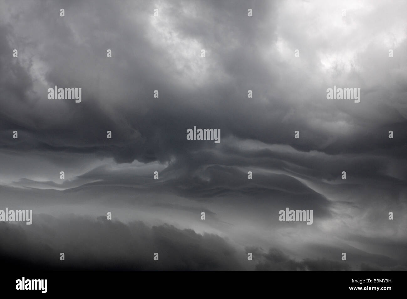 Turbulent stratified area of upper layers of thunderstorm showing clear delineation between different layers of - Stock Image