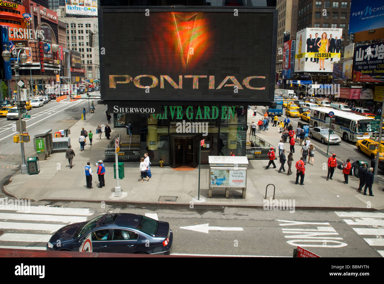 Advertising for General Motors Pontiac brand is seen in Times Square - Stock Image