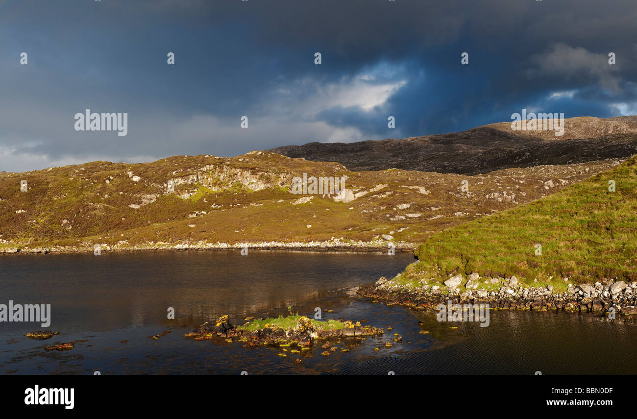 Storm light over an inland loch, east coast, Isle of harris, Outer Hebrides, Scotland - Stock Image