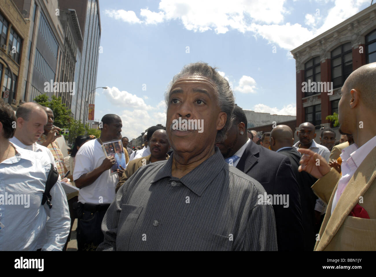 The Rev Al Sharpton leads hundreds of activists throught the streets of Harlem in New York - Stock Image