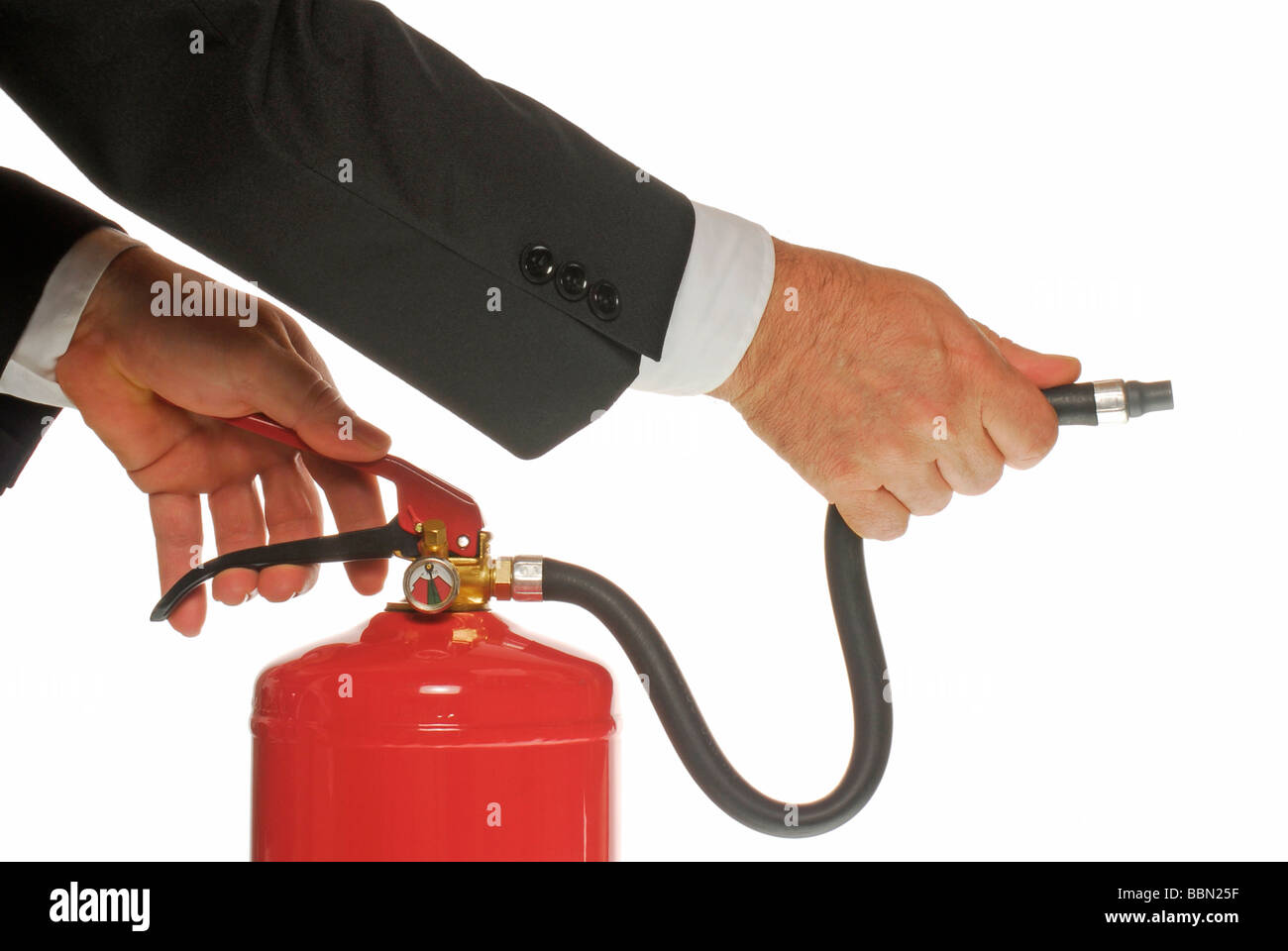 Manager's hand holding a fire extinguisher, symbolic image - Stock Image