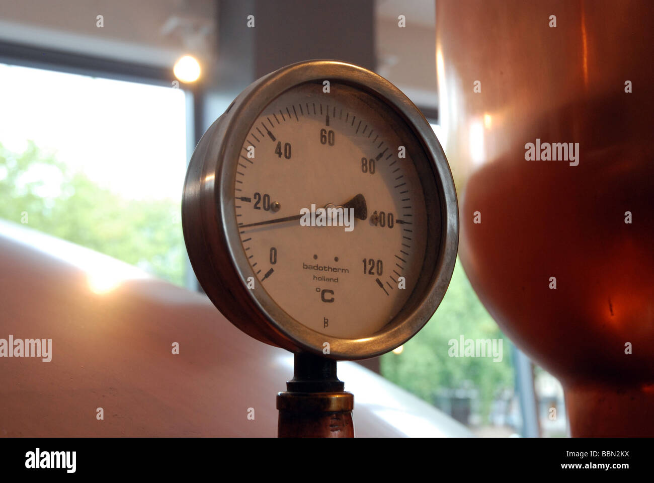 copper brass guage heineken beer amsterdam - Stock Image