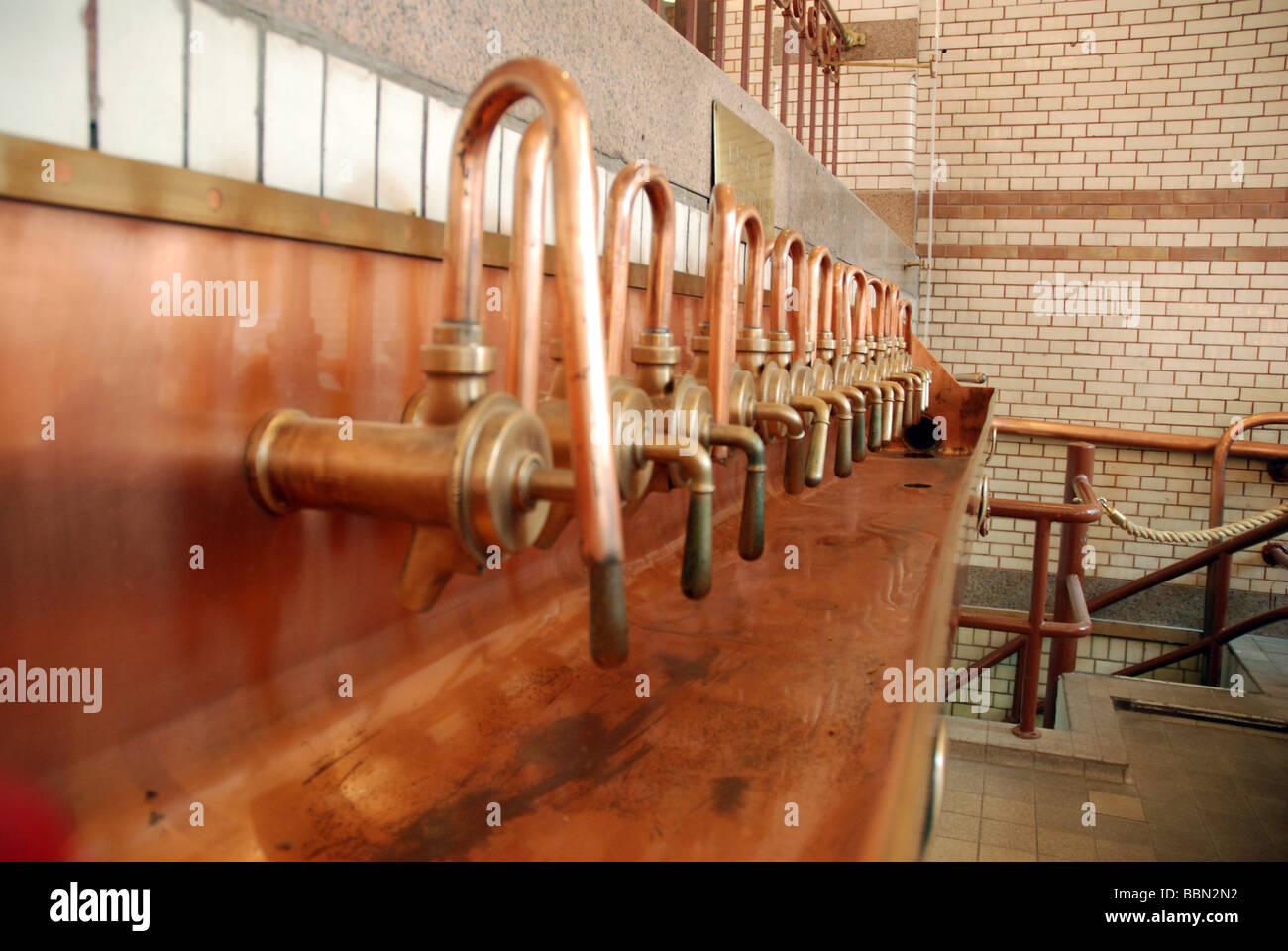 brewery amsterdam experience copper tasting taps - Stock Image