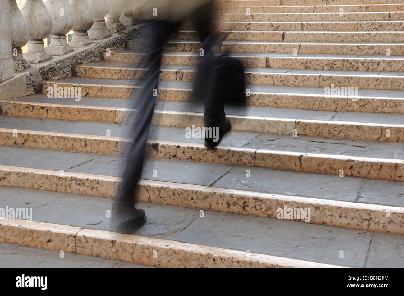 In a hurry, man walking to the Rialto Bridge, Venice, Italy, Europe - Stock Image