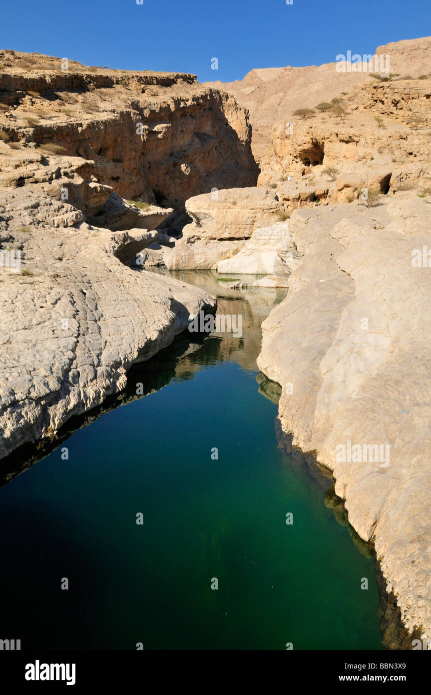 Water pool in a rocky canyon, Wadi Bani Khalid, Sharqiya Region, Sultanate of Oman, Arabia, Middle East - Stock Image