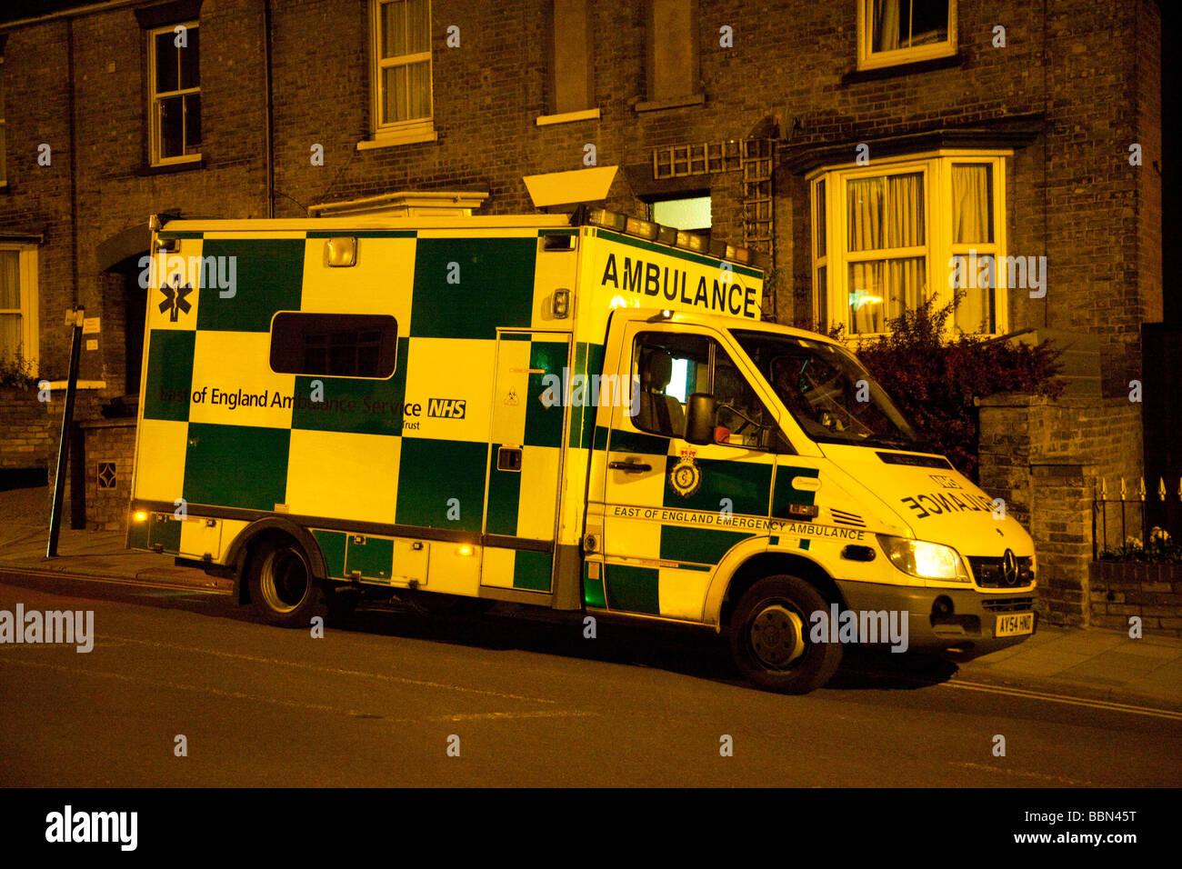 parked ambulance at night, UK - Stock Image