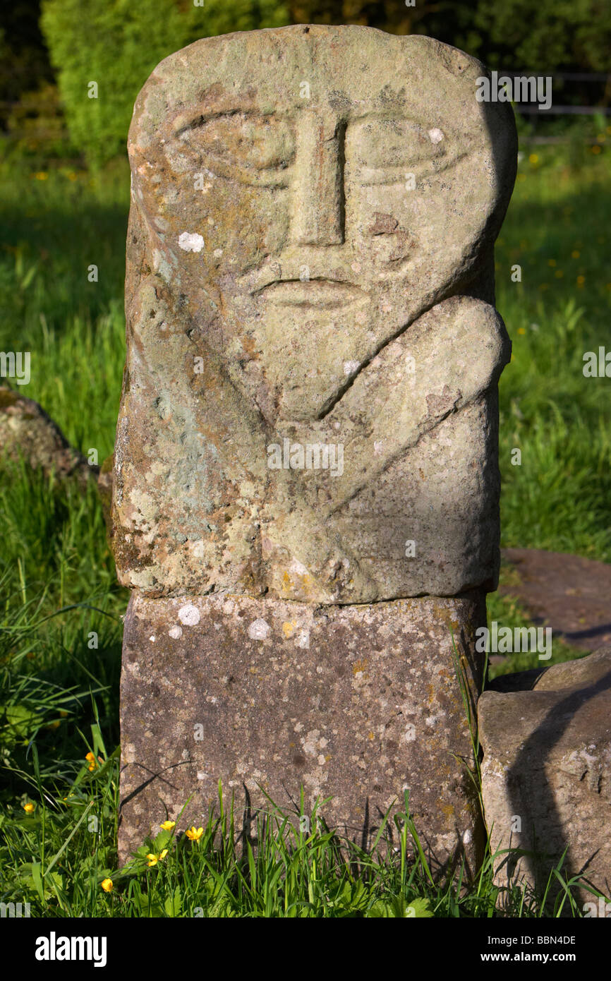 boa island bilateral carved stone figure often called the janus stone based on a celtic diety or goddess caldragh - Stock Image