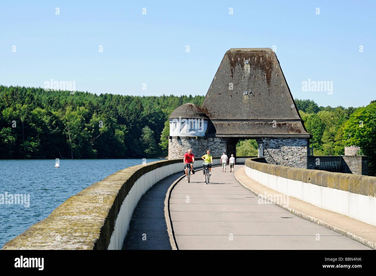 Dam, people, cyclists, recreational sports, Moehnesee lake, Moehne, reservoir, dam, North Rhine-Westphalia, Germany, Stock Photo