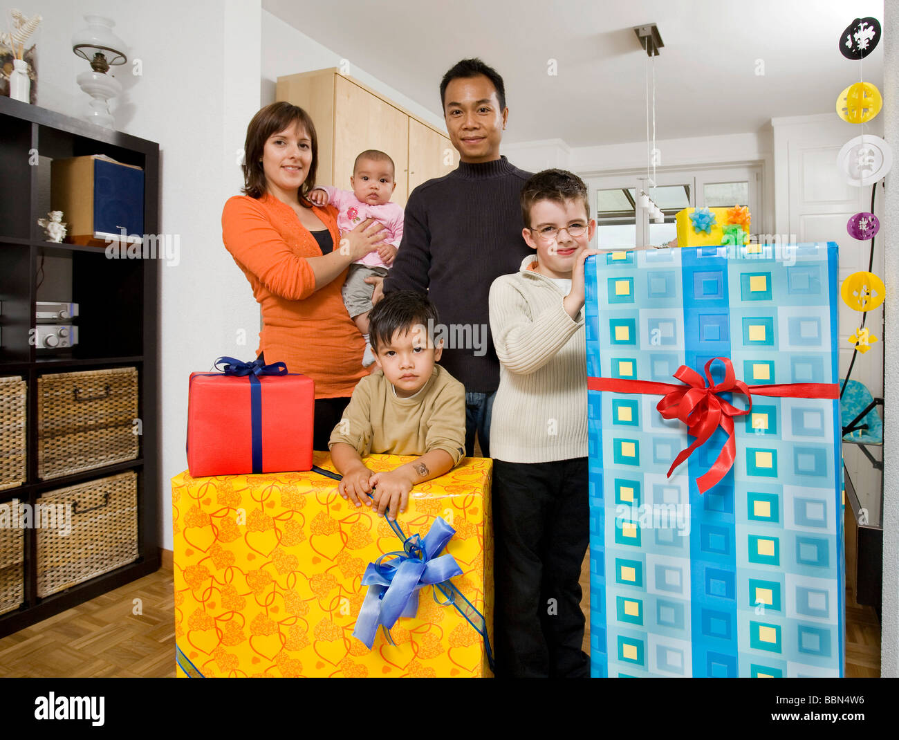 Family with gifts, Basel, Switzerland, Europe - Stock Image