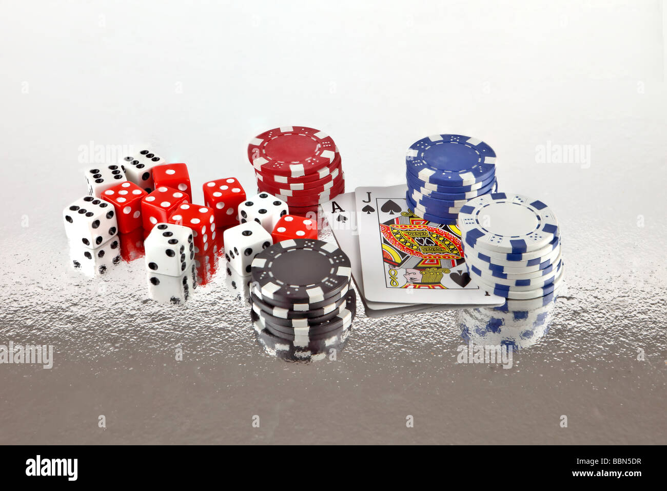 Gambling devices of dice cards and poker chips Stock Photo