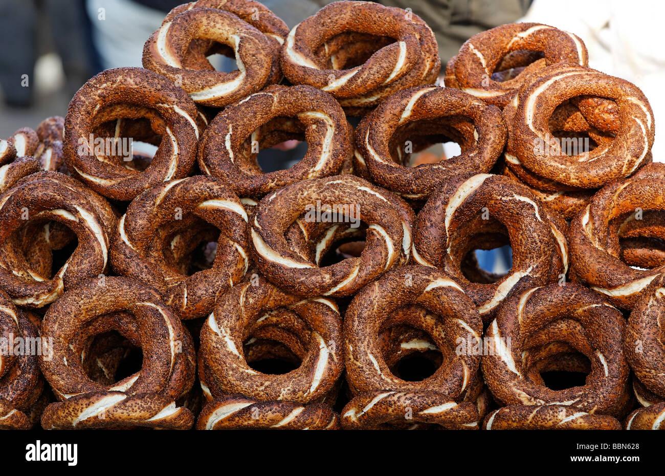 Stacked sesame bread loops, Simit, of a street vendor, Eminoenue, Istanbul, Turkey - Stock Image