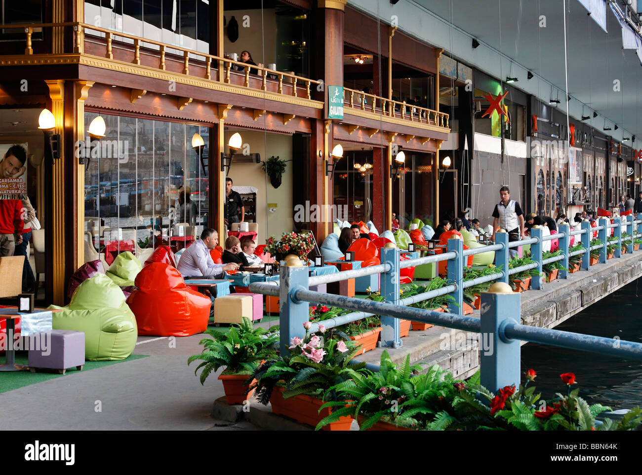 Basement of the Galata bridge, cafe with colorful beanbag outdoor seating, Istanbul, Turkey - Stock Image