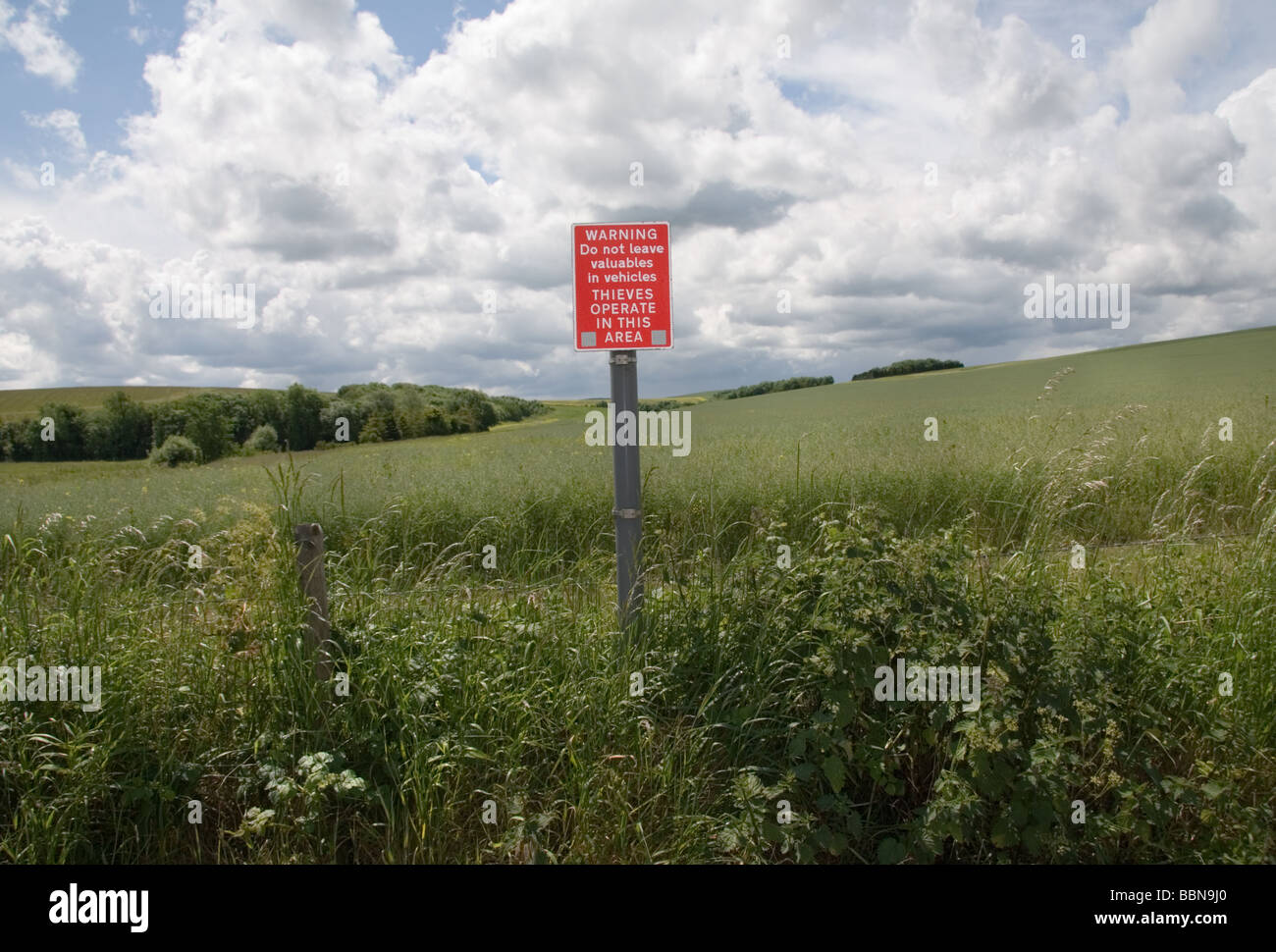 A warning sign against theft from cars in the Wiltshire countryside near Avebury, UK Stock Photo