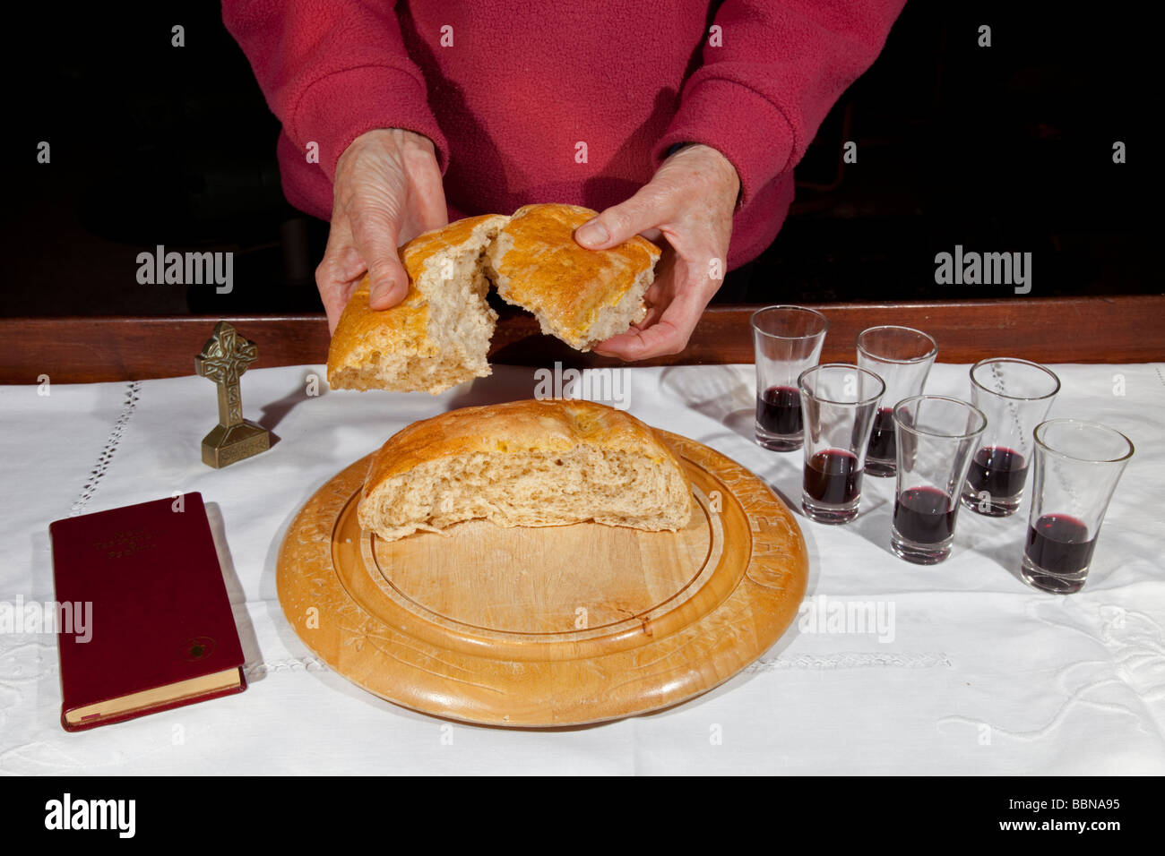 Woman Breaking Loaf Of Bread For Home Church Holy