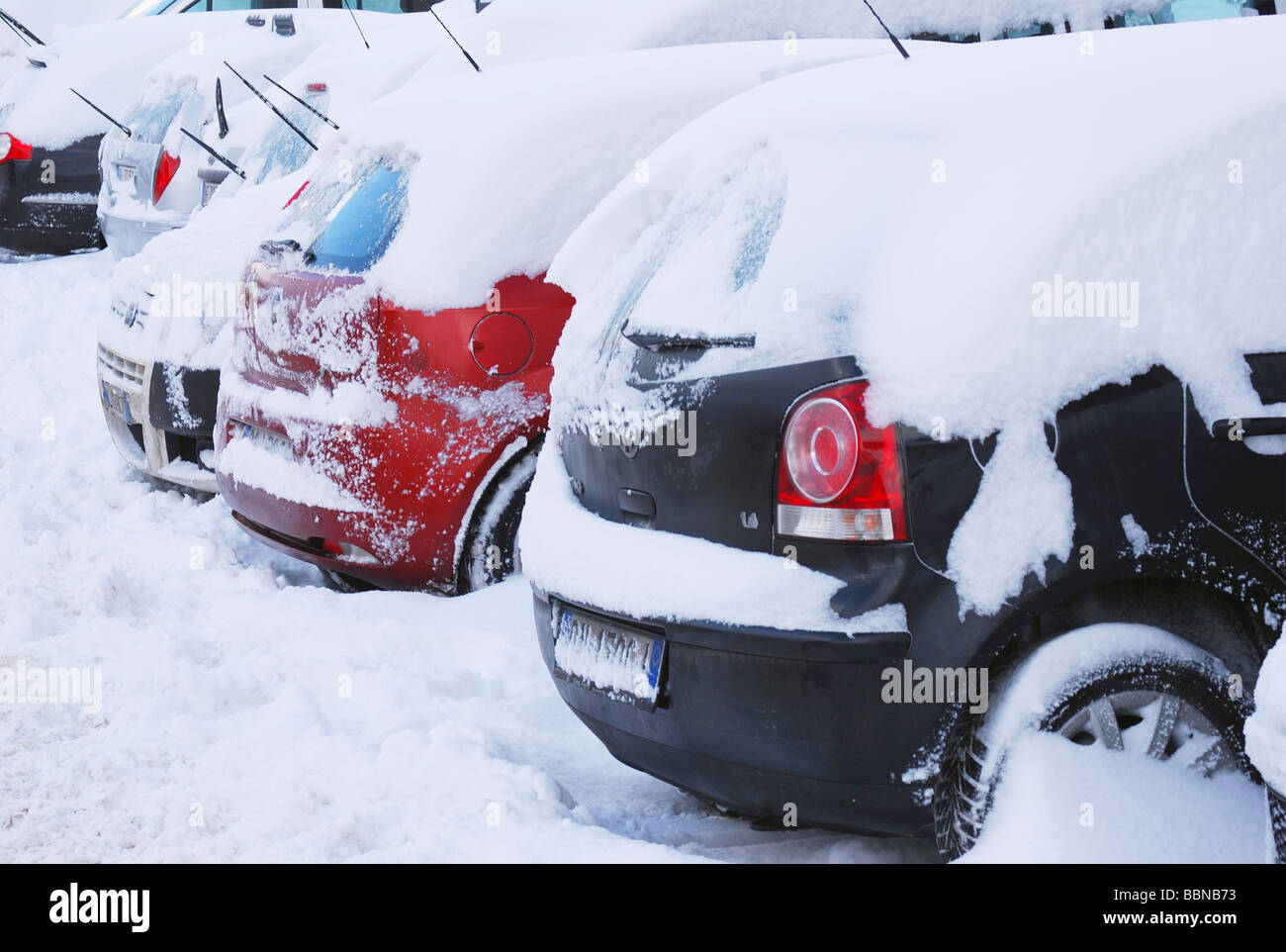 snow covered parked cars - Stock Image