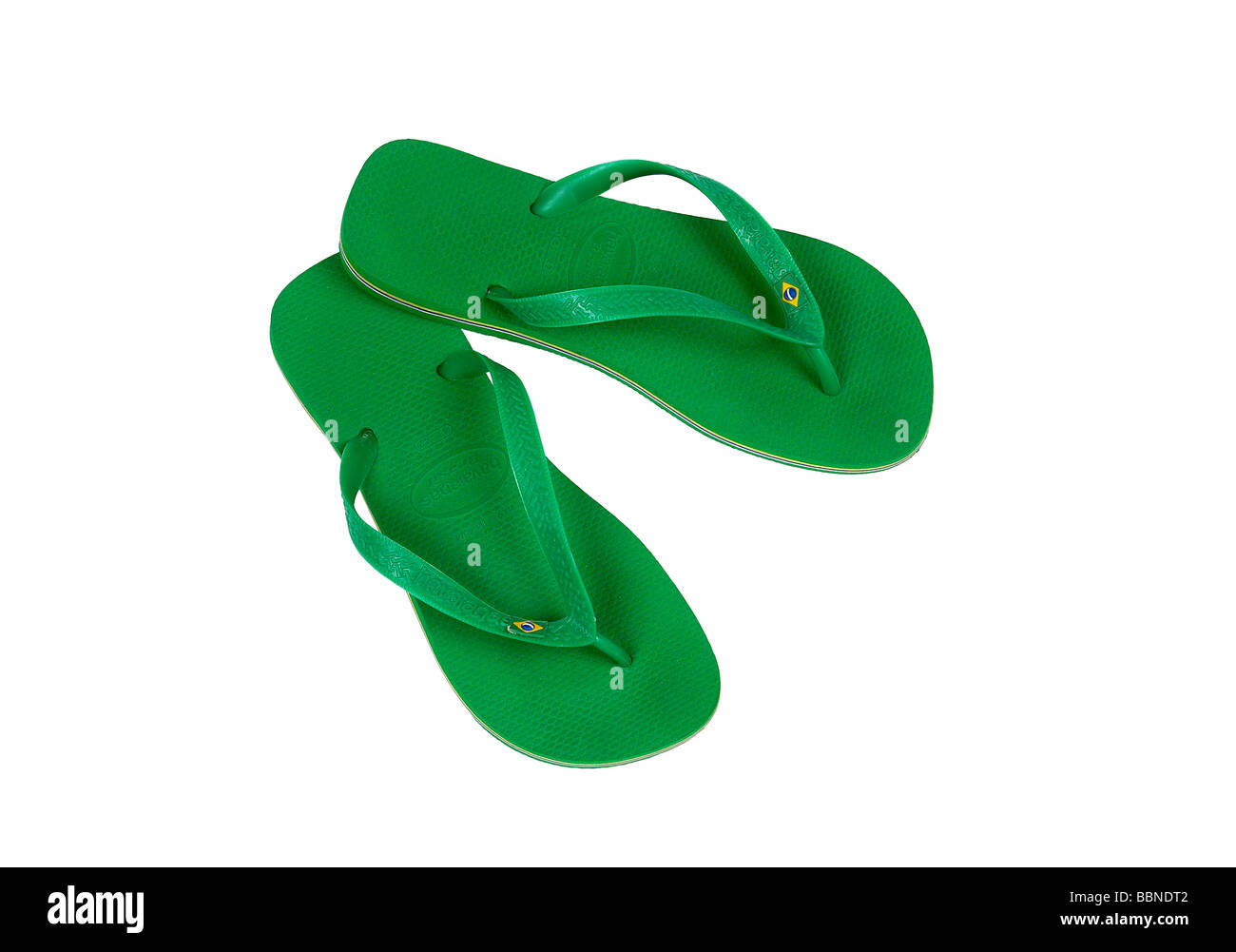 GREEN PLASTIC FLIP FLOP SHOES - Stock Image