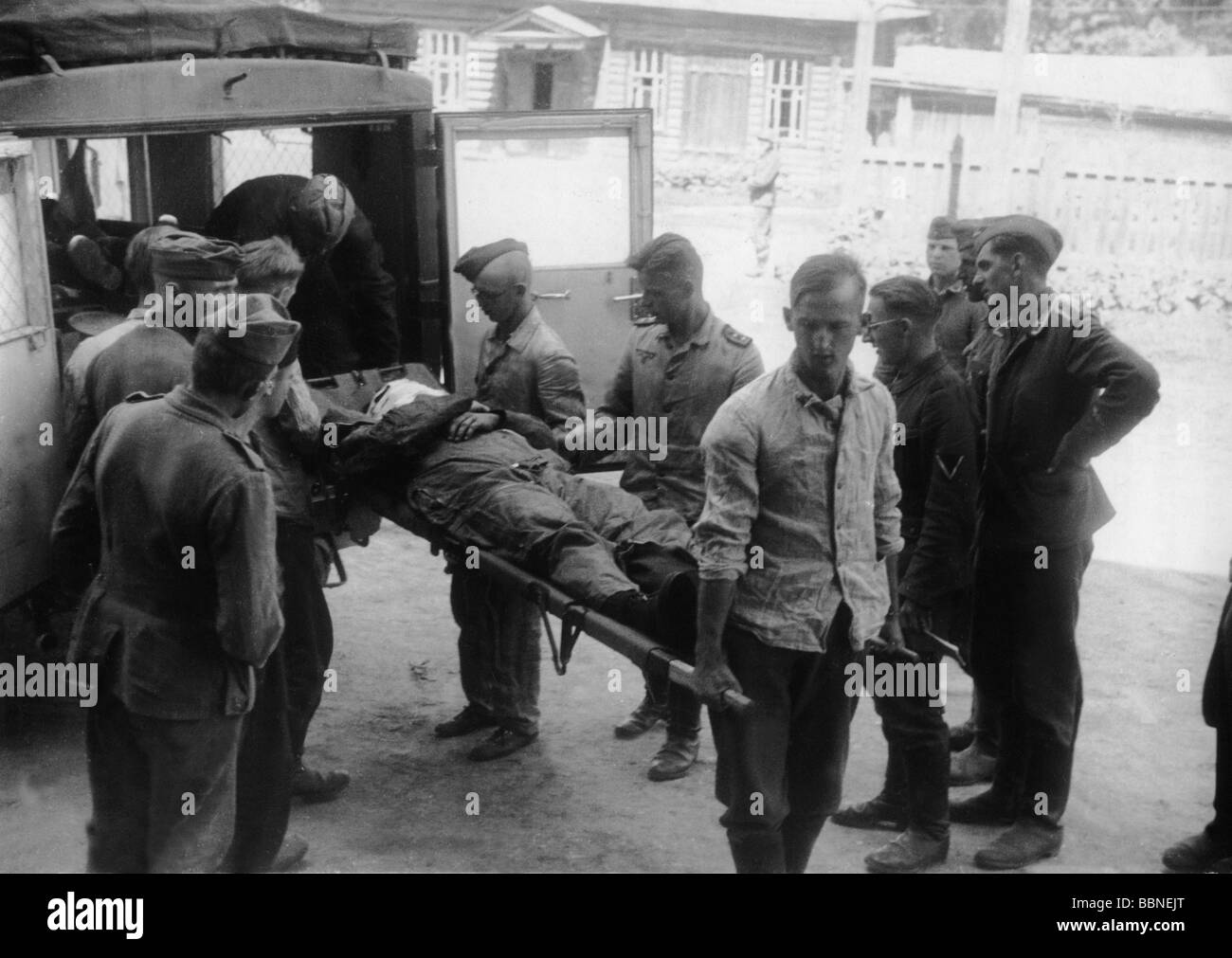events, Second World War / WWII, medical service, German airman, wounded in an aerial combat, is being brought to - Stock Image