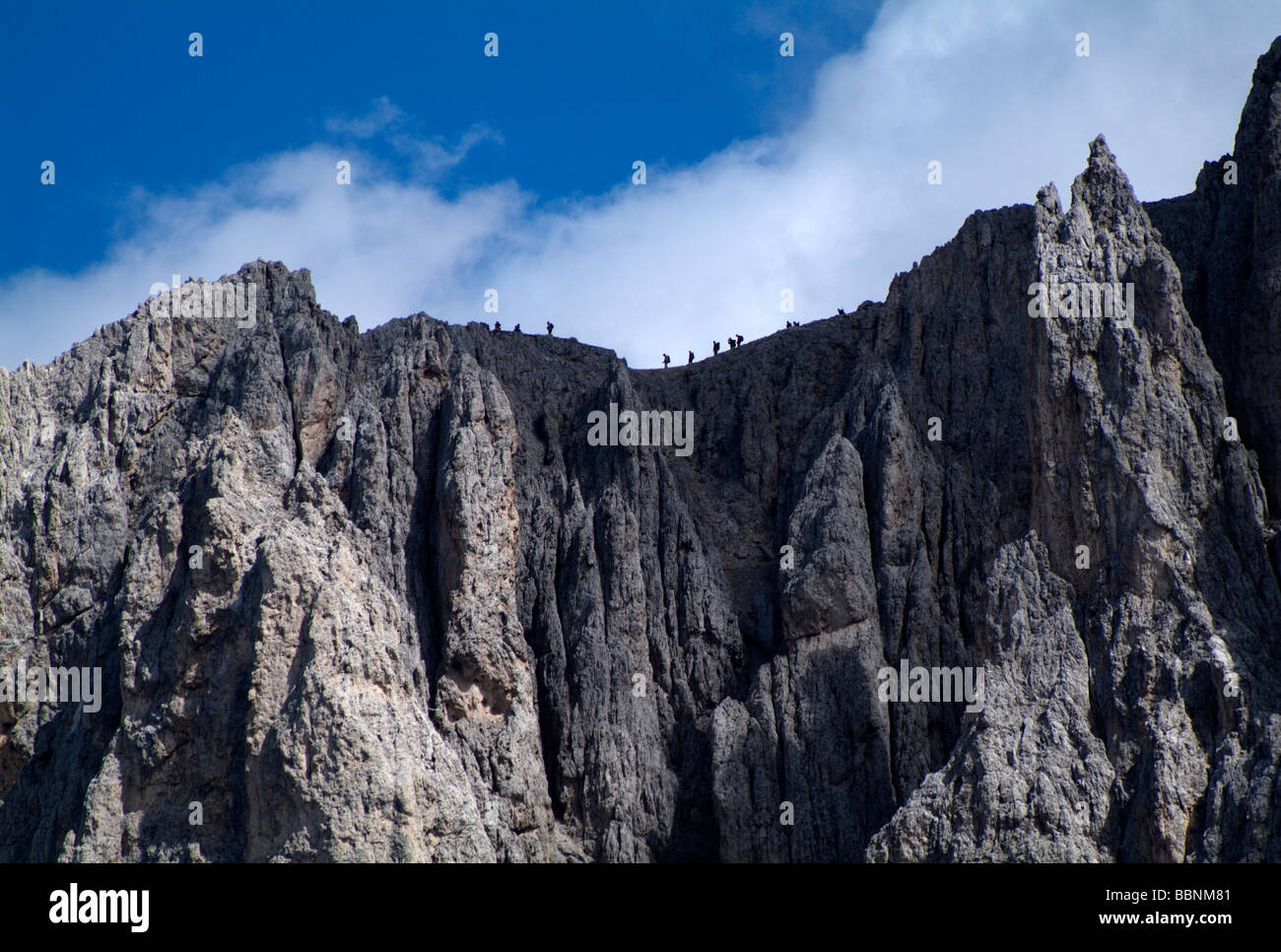 geography / travel, Italy, South Tyrol, hiker at King Laurin rock face, Rosengarten mountain range, Additional-Rights - Stock Image