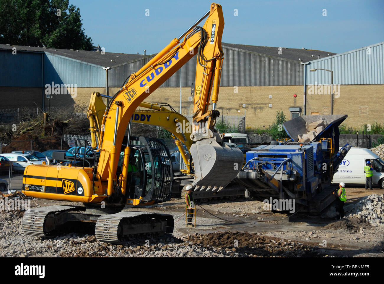 digger and concrete crusher - Stock Image