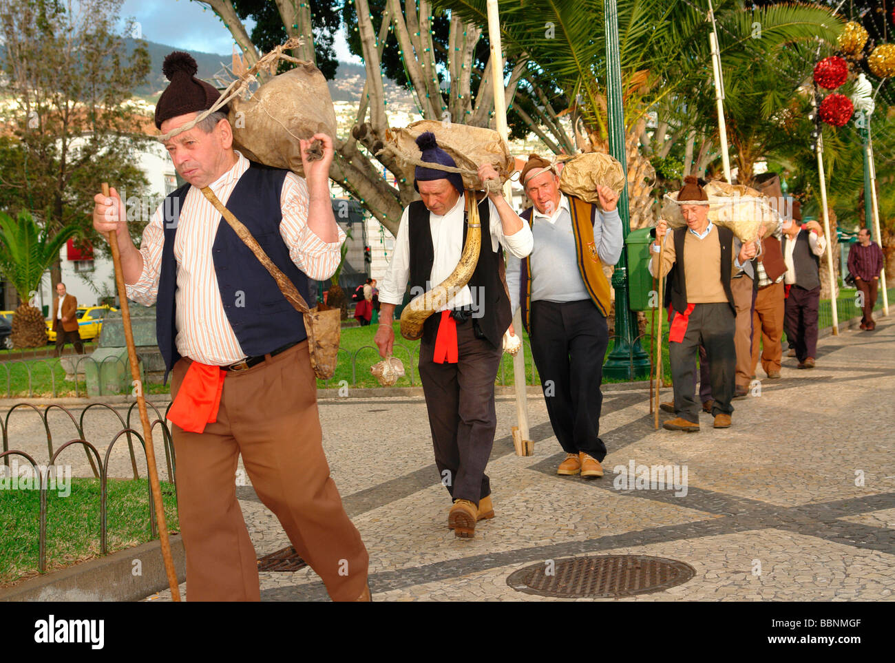 geography / travel, Portugal, Madeira, Funchal: Islanders from a Porto da Cruz folklore-group carrying wineskins, - Stock Image