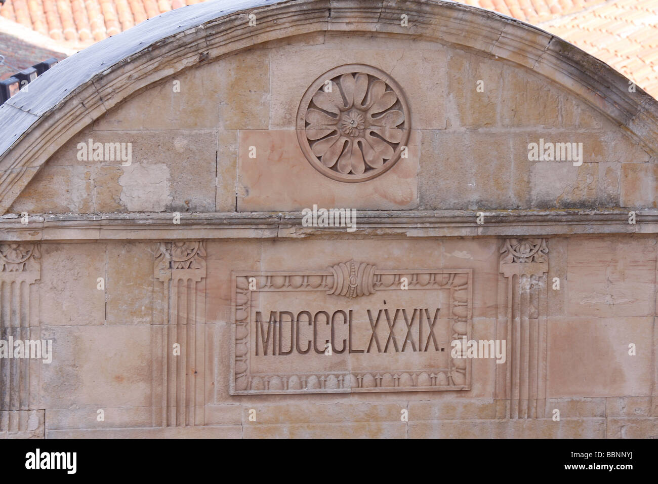 Roman numerals on a building wall dating its construction 1889 - Stock Image