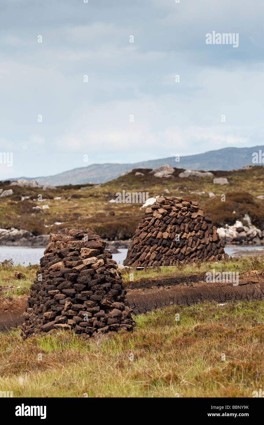 Cut Peats in stacks on moorland, Isle of Harris, Outer hebrides, Scotland - Stock Image