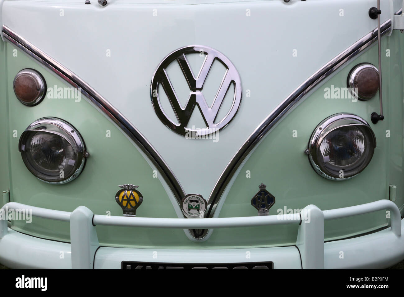Front Of Green And White Vw Camper Van Showing The Vw Badge Stock Photo Alamy