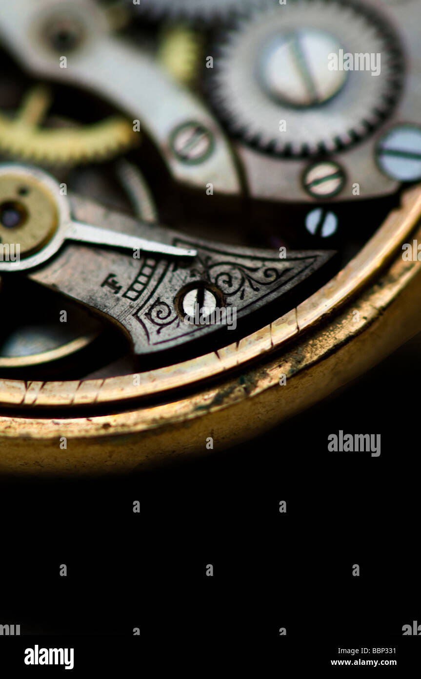 Image of the inner workings of an antique pocket watch - Stock Image