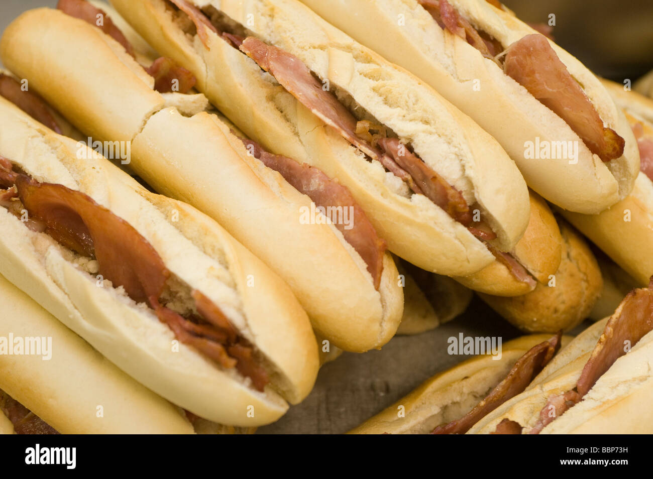 Tray full of bacon baguettes - Stock Image