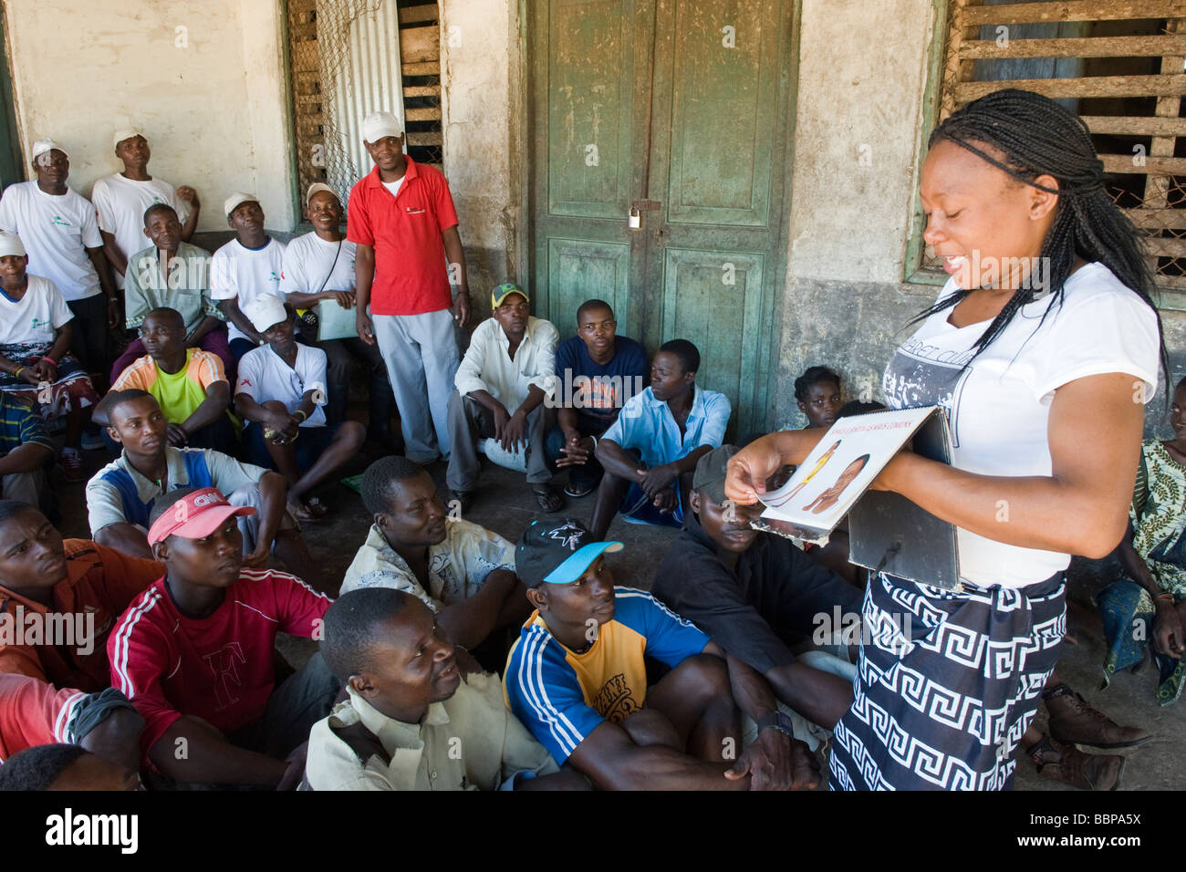 NGO staff implementing a AIDS HIV awareness campaign Quelimane Mozambique - Stock Image