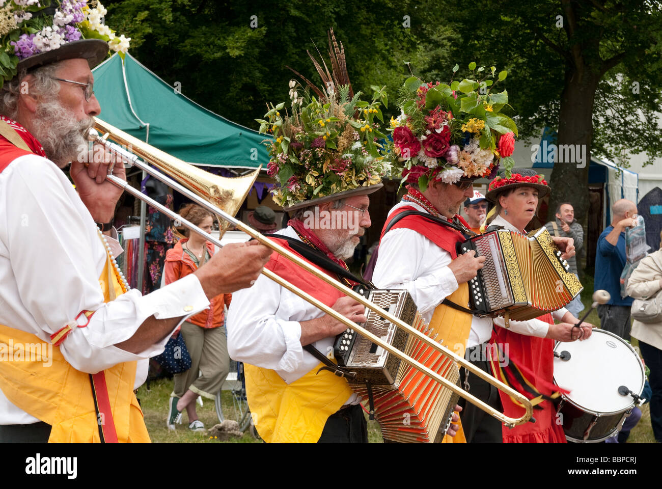 Traditional morris dancers (Knockhundred Shuttles Clog Morris) in full dress and hats at a country garden show - Stock Image