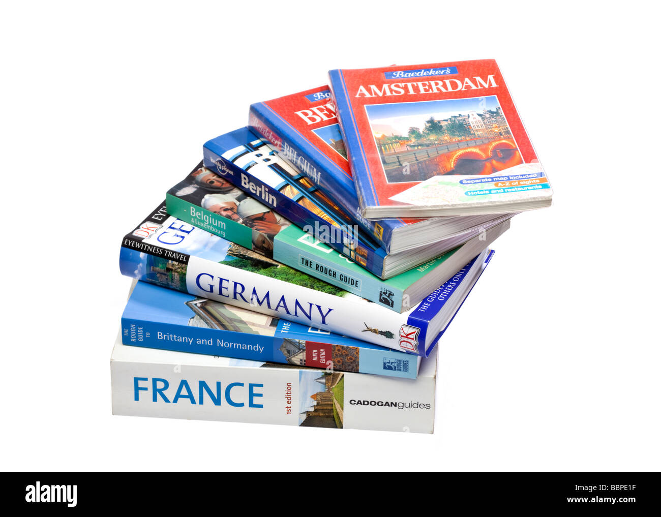 Stack of European travel guide books on white - Stock Image