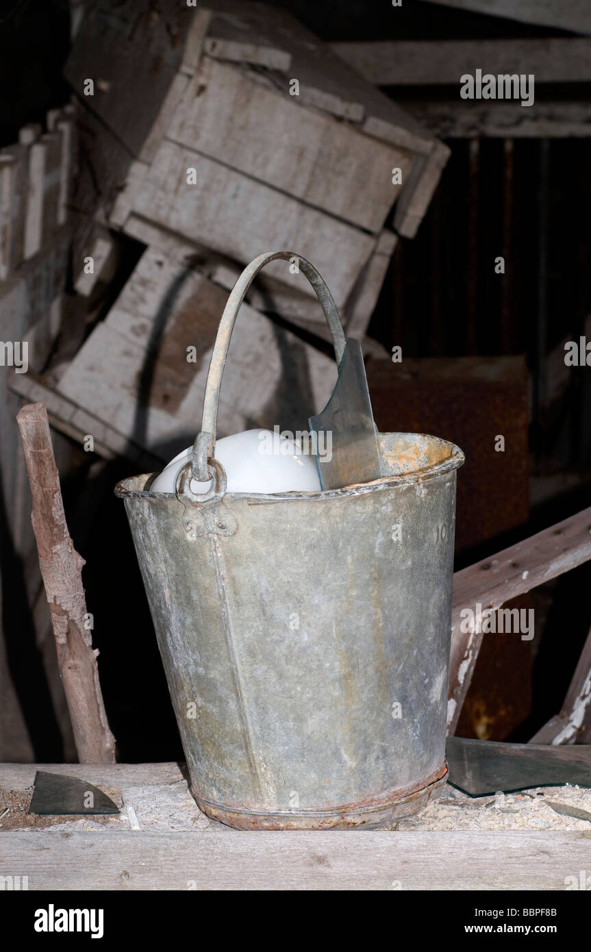 Aluminium bucket and other old junk - Stock Image