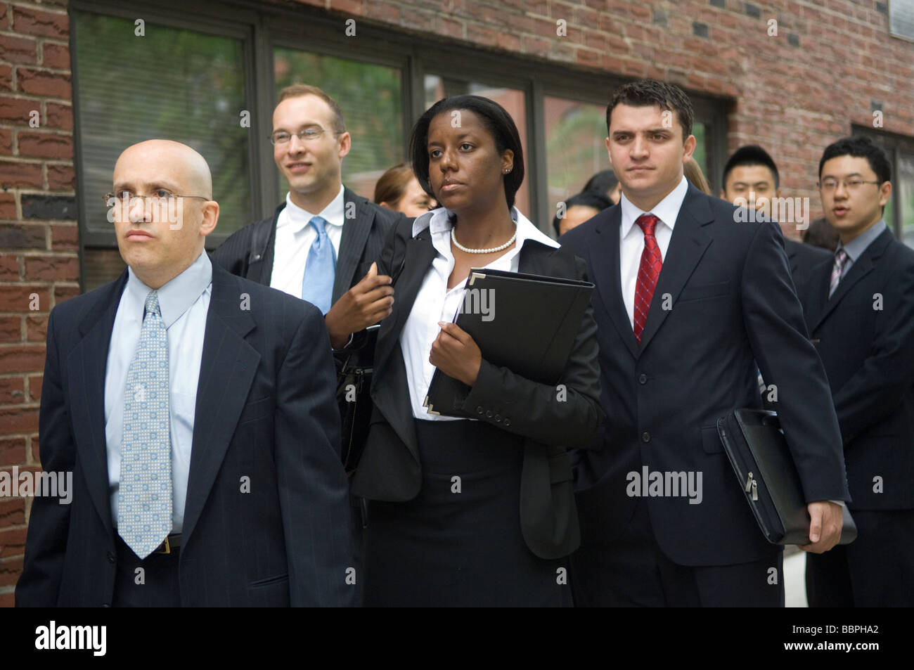 Job seekers attend the MyWorkster Multi School Alumni Job Fair at Baruch College in New York - Stock Image