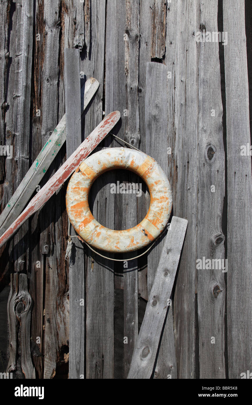 vintage life belt and paddles at wooden facade, Estonia, Baltic Nation, Eastern Europe. Photo by Willy Matheisl - Stock Image