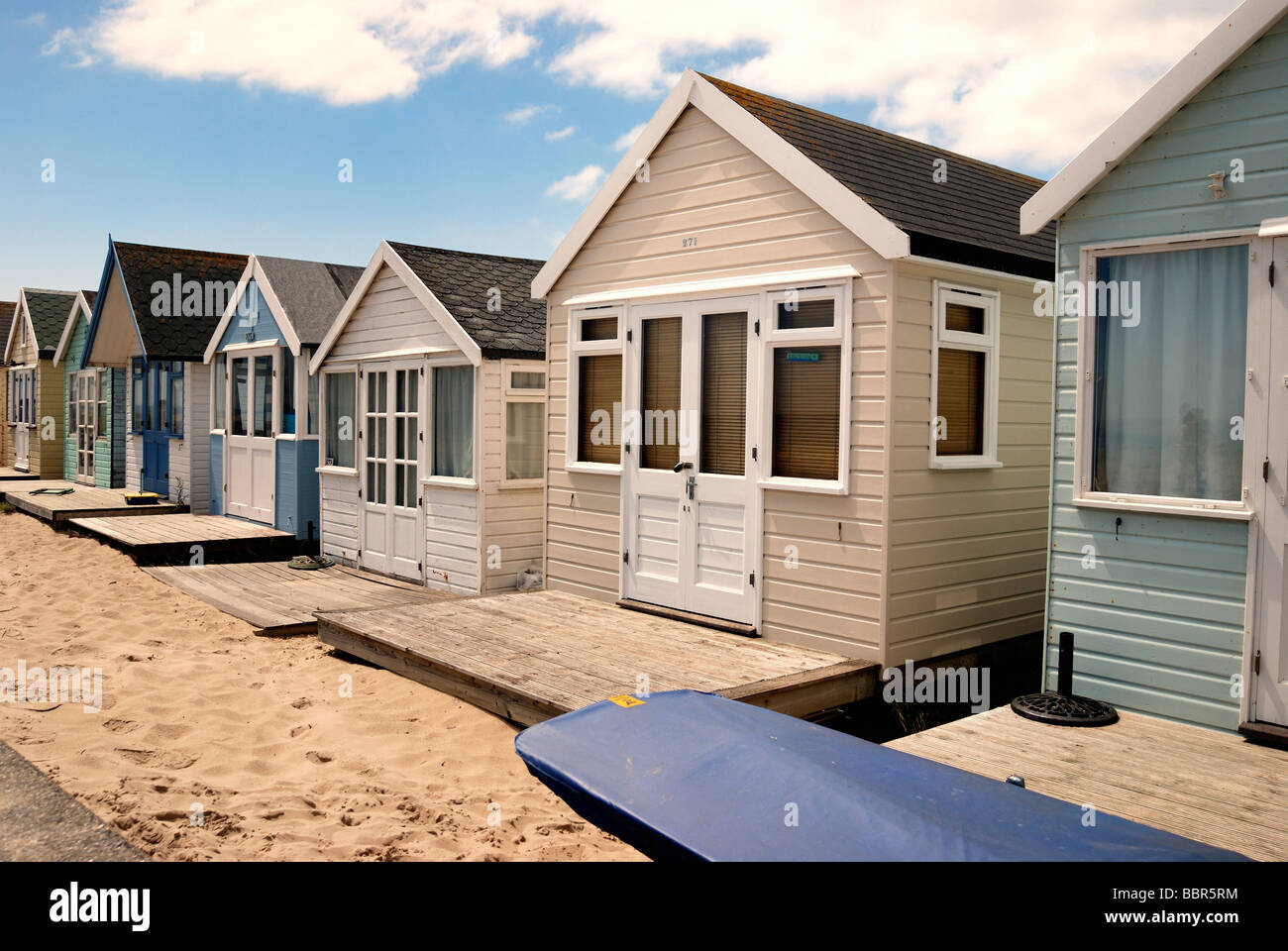 A row of large deluxe beach hut - Stock Image