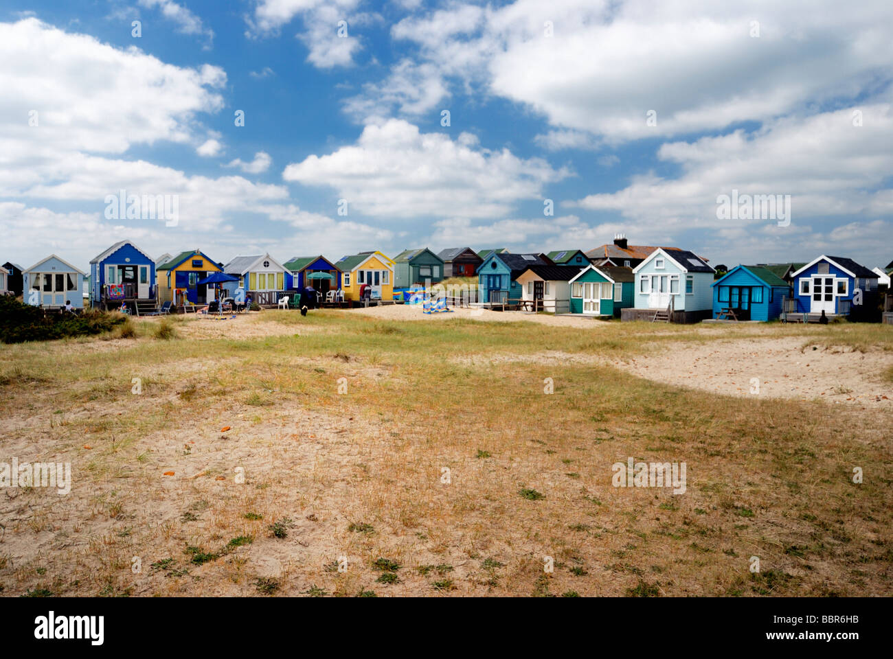 A row of large deluxe beach huts - Stock Image