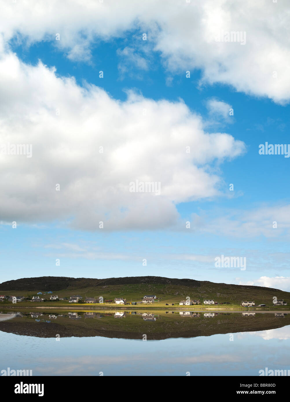 Seallam village reflecting in calm sea water, South Harris, Outer Hebrides, Scotland - Stock Image
