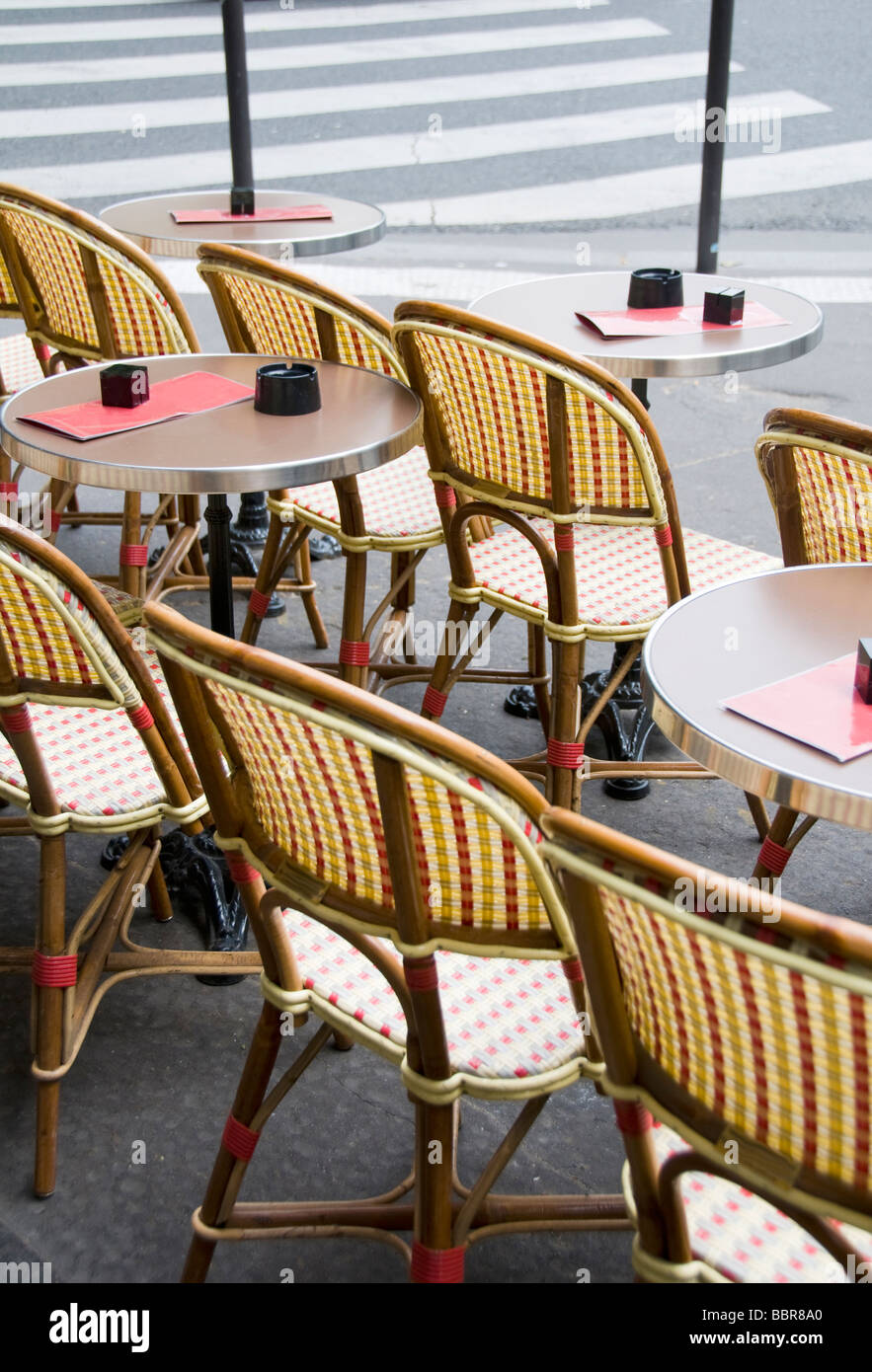typical generic outdoor cafe setting paris france with tables and chairs on the sidewalk & typical generic outdoor cafe setting paris france with tables and ...