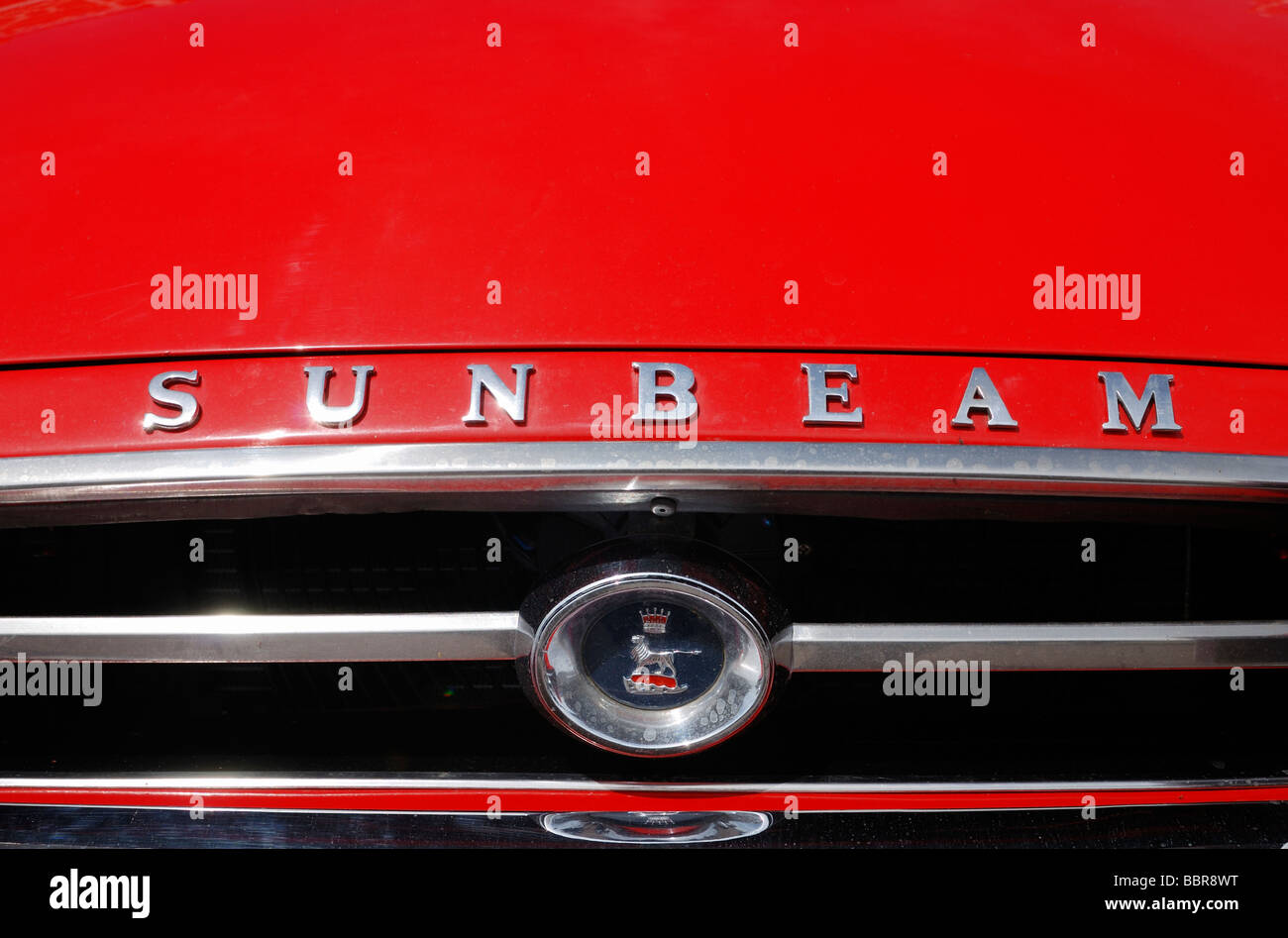 A Sunbeam badge and motif on a red bonnet - Stock Image