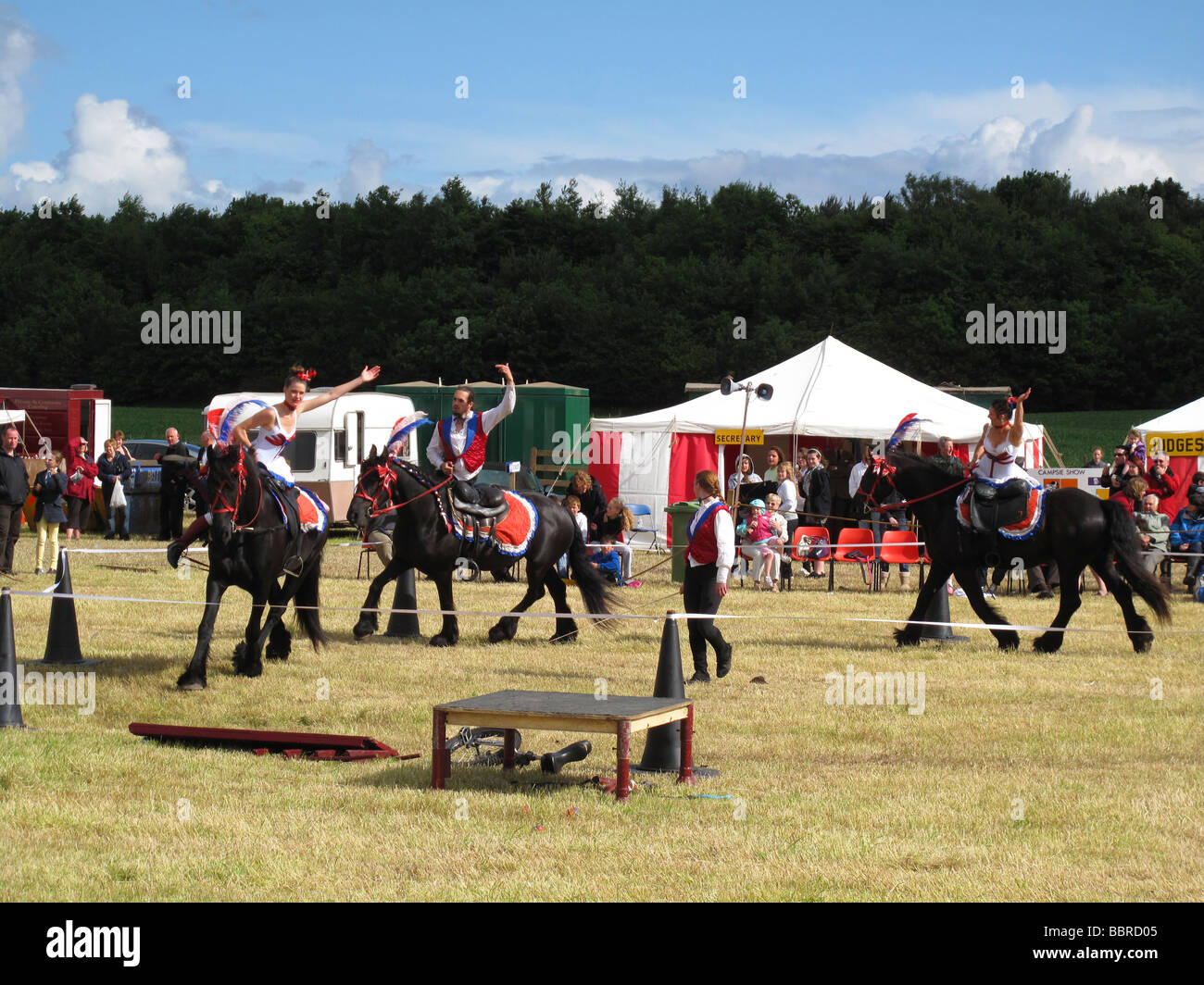Stunt display riding act at country show - Stock Image