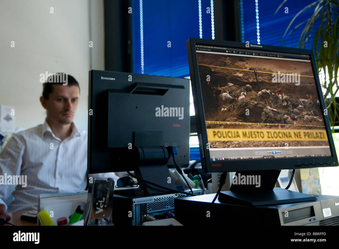 A man works with a computer in ICMP commission of missing persons in Sarajevo, Bosnia - Stock Image
