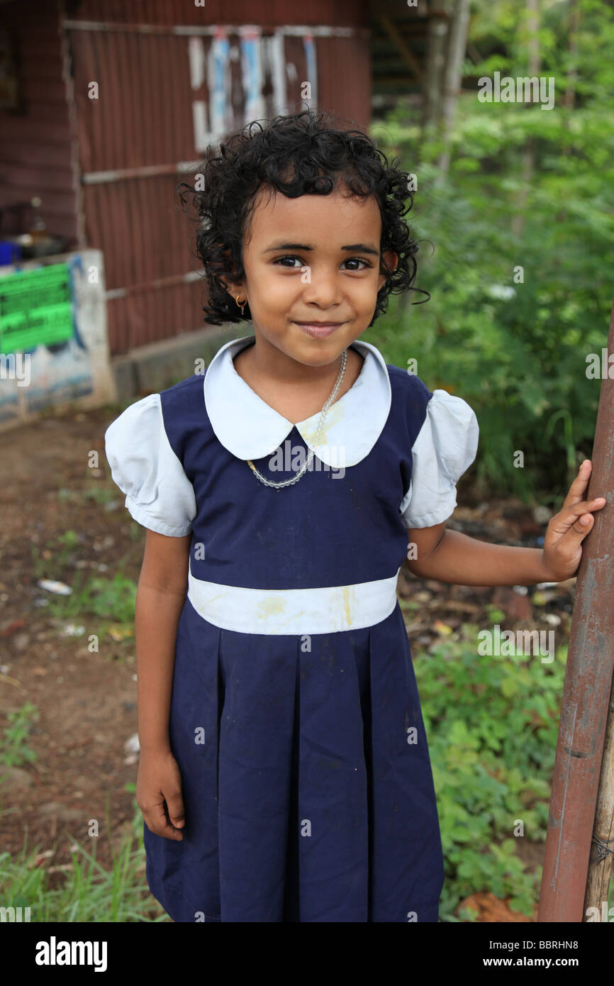 Poor Indian schoolgirl wearing her school uniform - Stock Image