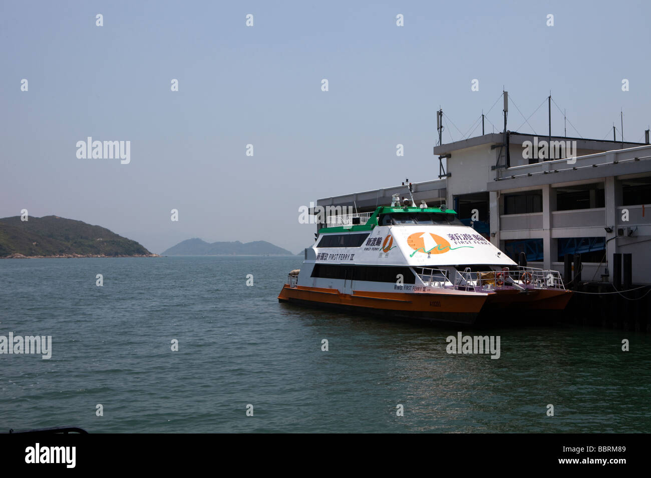 A ferry is seen at the pier on Lantau Island, Hong Kong - Stock Image