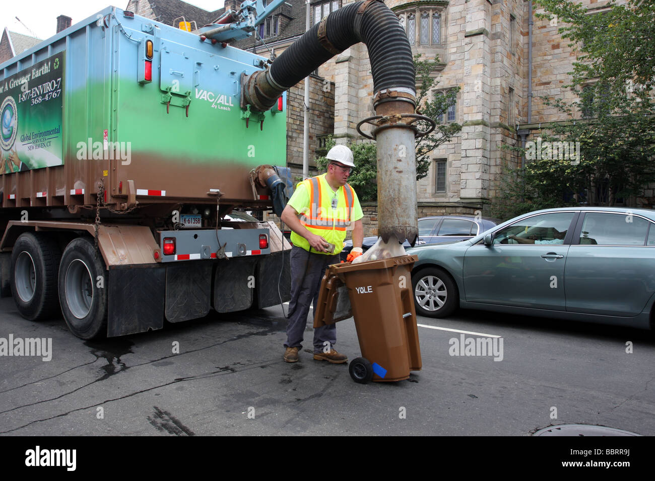 A recycling truck using a newly developed vacuum sucks up recyclables in New Haven Connecticut at Yale University - Stock Image